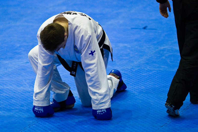 Taekwon-Do fighter taking a knee