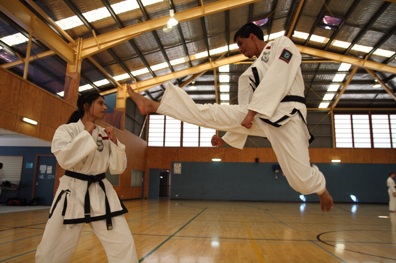 A Taekwon-Do jumping front kick - the skill of the black belts in class can help you decide whether to choose a martial arts club