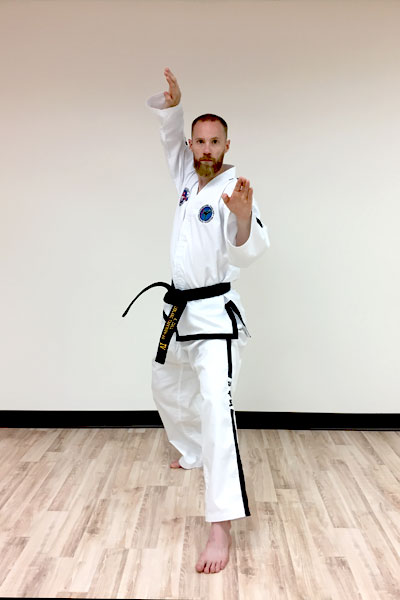 A taekwon-do twin knife-hand block.