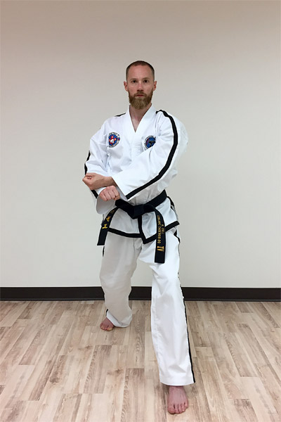The preparation for a forearm rising block in taekwon-do