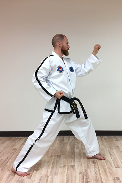 Taekwon-do outer forearm high side block (side view)