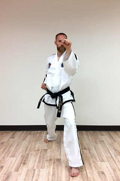 Taekwon-do outer forearm high side block (front view)